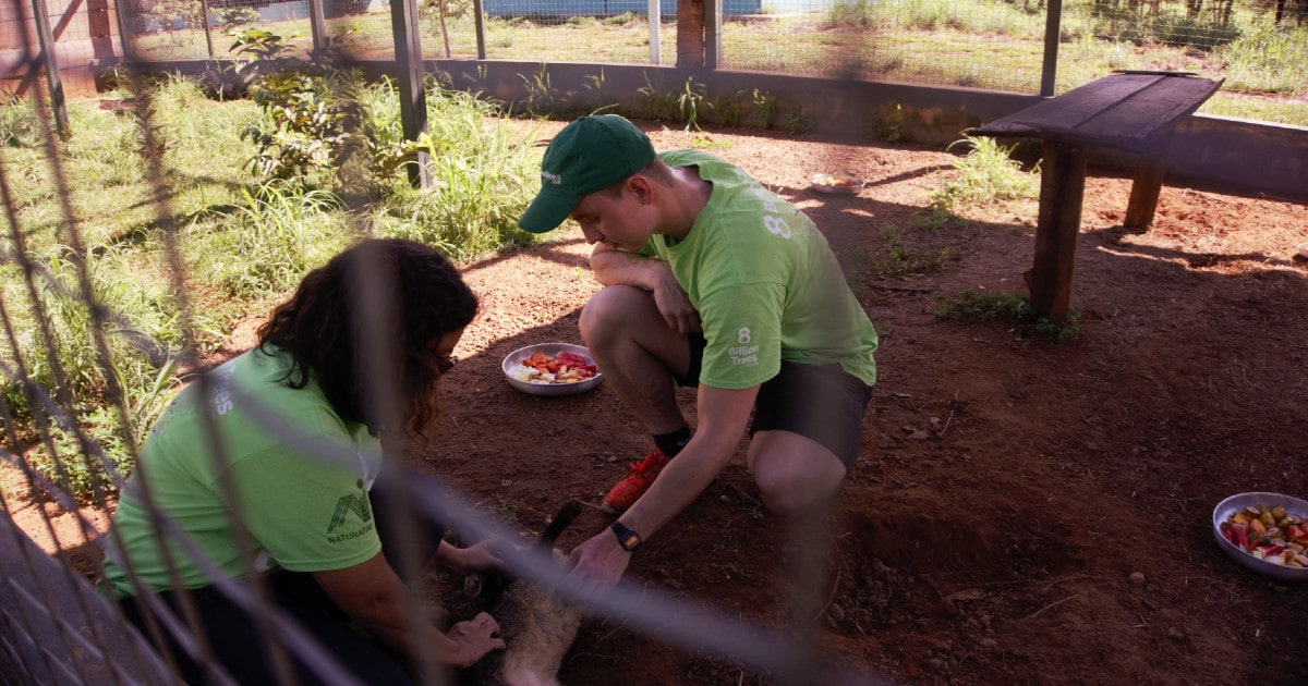 Co-founder Jon Chambers feeding an animal at wildlife preservation facility