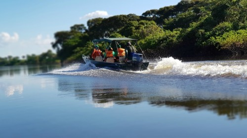 The 8 Billion Trees team speeding in a boat to a remote planting location in Brazil.