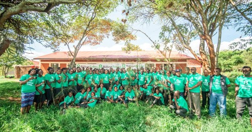 Approximately 50 8 Billion Trees team members in Kenya posing and smiling for a group picture