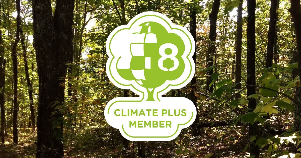 CLimate Plus membership badge atop scene from forests in Tennessee.