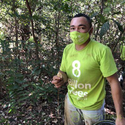 8 Billion Trees team member hold sucupira seed.